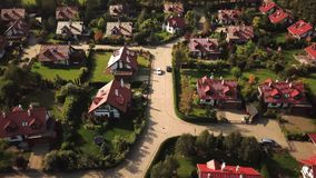 Aerial view from low-flying airplane of residential estates in wealthy neighborhood on a hill. stock video