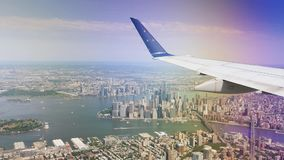 Aerial View of Lower Manhattan as Seen from Landing Airplane. 8626 An aerial view of lower Manhattan as seen from the window of a landing jetliner stock footage