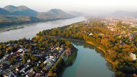 Aerial view of Luang Prabang and surrounding lush mountains of Laos. Nam Kahn River, a tributary of the Mekong River stock video footage
