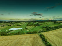 Aerial view of lush green farmland Royalty Free Stock Photo