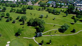 Aerial view of a lush green golf course stock video