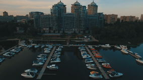 Aerial view on luxury apartments with pier and boats 4K. Aerial view on luxury apartments with pier and boats UHD stock video
