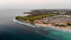 Aerial view of luxury golf course next the cliff, ocean and beach in Bali island, Indonesia. stock video footage