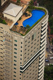 Aerial View of Luxury Hotel Rooftop Pool royalty free stock images