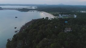 Aerial view of luxury hotel surrounded by trees and next to the ocean and blue turquoise water. Shot. Luxurious villa. Aerial view of luxury hotel surrounded by stock footage