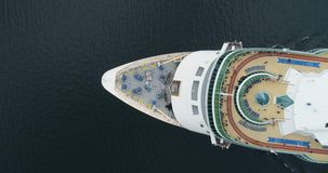 Aerial view of luxury medium cruise ship sailing to port through the bay