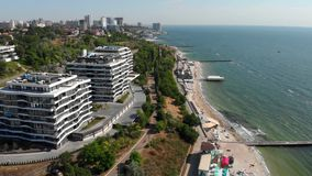 Aerial View of luxury residential complex Beachfront apartments close to the Sea Shore. 4k UHD stock video footage
