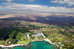 Fairmont Orchid, Big Island, Hawaii. Aerial view of the luxury resort Fairmont Orchid on the west coast of Big Island, Hawaii, USA, with clouds over the summit Stock Photos