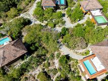 Aerial view of luxury villa with swimming pool in tropical forest. royalty free stock image