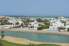 Aerial view of luxury waterfront holiday villas on coast Stock Images