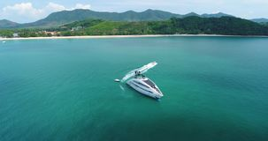 Aerial view of luxury yacht in the sea near the beach. Small boat going out from the big sheep. Thailand stock footage