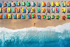 Aerial view of lying woman on the beach with colorful chaise-lounges Stock Photography
