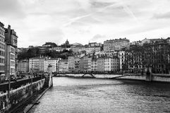 Aerial view of Lyon in autumn. Lyon, France. Aerial view of Lyon in autumn with River and Bridge, France. Historical buildings with cloudy blue sky. Black and Stock Photography