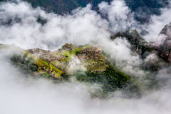 Aerial View of the Magestic Machu Picchu in the clouds. Birds eye view of the magestic Machu Picchu in the clouds. It is also the view of Machu Picchu from the Stock Photo