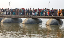 Thousands of Hindu devotees crossing the pontoon bridges over the Ganges River at Maha Kumbh Mela festival Stock Photography