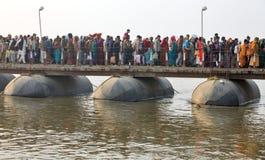 Thousands of Hindu devotees crossing the pontoon bridges over the Ganges River at Maha Kumbh Mela festival Stock Photography