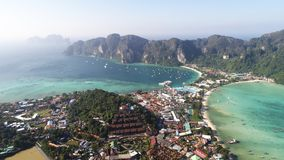 Aerial view of main Pier Ton Sai  on Phi Phi Island during sunny summer day. Aerial drone view of main Pier Ton Sai  on Phi Phi Island during sunny summer day Royalty Free Stock Image