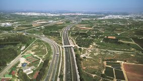 Aerial view of major highway traffic on a sunny day, Autopista del Mediterraneo, Spain. Aerial view of major highway traffic stock photos
