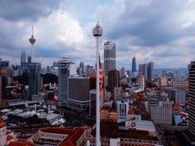 Kuala Lumpur,Malaysia - December 28, 2017: Aerial view of Malaysia`s flay with Kuala Lumpuor City skyline ubackgr Royalty Free Stock Photography