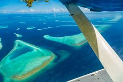 Aerial view of Maldives beach landscape. Maldives island view from seaplane or drone royalty free stock images