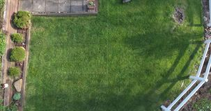 Aerial View Man Cutting Grass stock footage