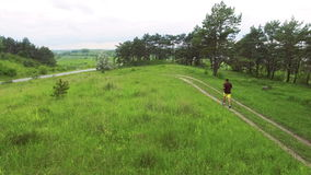 Aerial view of man running cross on the lawn. Camera follow behind 4k. Aerial view of man running cross on the lawn. Camera follow behind. 4k stock video footage