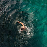 Aerial view of man swimming front crawl Stock Photo