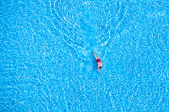 Aerial view of a man swimming in the pool Stock Images