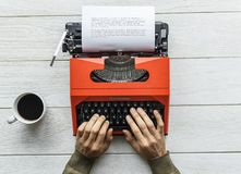 Aerial view of a man typing on a retro typewriter Royalty Free Stock Photos