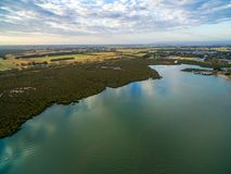 Aerial view of mangroves and meadows near ocean coastline at sunset in Australia. Aerial view of mangroves and meadows near ocean coastline at sunset in Stock Image