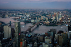 Aerial view of Manhattan and Brooklyn bridges showing variety of shapes and patterns of buildings and shoreline Royalty Free Stock Photos