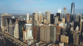 Aerial view of the Manhattan district in New York, America. Drone flying over the busy city near the East river.