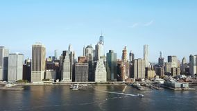 Aerial view of the Manhattan downtown in New York, America. Water transport riding through the East river. Beautiful landscape of downtown on the coast stock footage