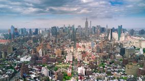 Aerial view of Manhattan, New York City. Skyscrapers around. Sunny day, aerial timelapse dronelapse. Clouds on background stock video