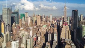 Aerial view of Manhattan, New York City. Skyscrapers around. Sunny day, aerial timelapse dronelapse. Clouds on background stock footage