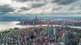 Aerial view of Manhattan, New York City. Skyscrapers around. Sunny day, aerial timelapse dronelapse. Clouds on background stock video footage