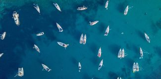 Aerial view of many anchoring yacht in open water. royalty free stock photos
