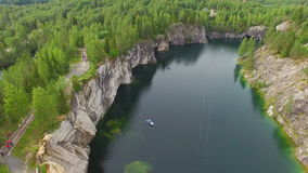 Aerial view of marble canyon with a lake in the middle. Marble canyon with trees, rocks and a lake in the middle. The water in the lake has a green tint on the stock video