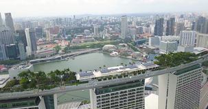 Aerial view of Marina Bay Sands with pool, garden, restaurant on the roof and panorama of Singapore. stock footage