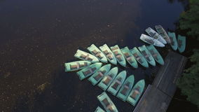 Aerial view of Marina with lots of tethered row boats stock video