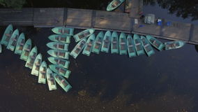 Aerial view of Marina with lots of tethered row boats stock video footage
