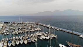 Aerial view of the Marina. Parking boats from a height. Port with yachts. City pier. Aerial view. 4K