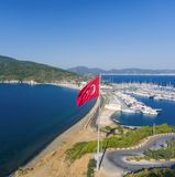 Aerial view of the marina and Turkish flag. Seaside landscape. royalty free stock photo