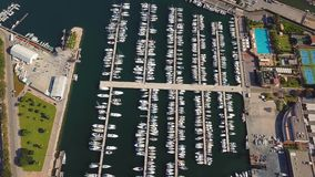 Aerial view of the marina with yachts in Valencia to the west of the commercial port. Aerial view of the marina with yachts in Valencia to the west of the stock video footage