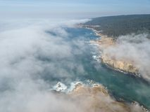 Aerial View of Marine Layer Drifting Over California Coastline. Fog drifts across the beautiful northern California coastline in Sonoma. Thick fog, generated by stock images