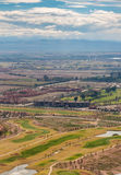 Aerial view on Marrakesh luxury suburbs with golf club. On foreground and Atlas mountains in background. Vertical view from top Royalty Free Stock Photography