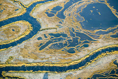 Aerial view of marsh, wetland abstraction of salt and seawater, and Rachel Carson Wildlife Sanctuary in Wells, Maine Royalty Free Stock Images