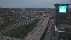 Aerial view of a massive highway intersection in Moscow. View from the sky on City landscape at night. Evening traffic stock video footage
