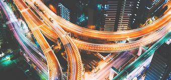 Aerial view of a massive highway intersection in Tokyo, Japan. Aerial view of a massive highway intersection at night in Shinjuku, Tokyo, Japan Royalty Free Stock Image