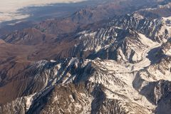 Aerial view massive snow mountain range in Georgia.  royalty free stock photography